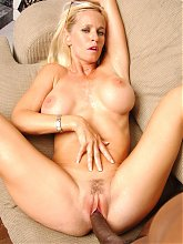 Tabitha cheats on her husband by inviting a black guy over to bone her on the couch