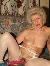 Francesca and Erlene are naughty grandmas in stockings spreading their pussies with dildos