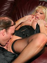 Naughty mature chick Kandi Cox uses her pair of huge melons to empty out a stiff prick